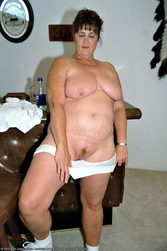Nude mature small breast redhead