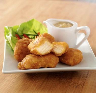 Рецепт Золотистые куриные кусочки вкукурузных хлопьях сабрикосовым соусом