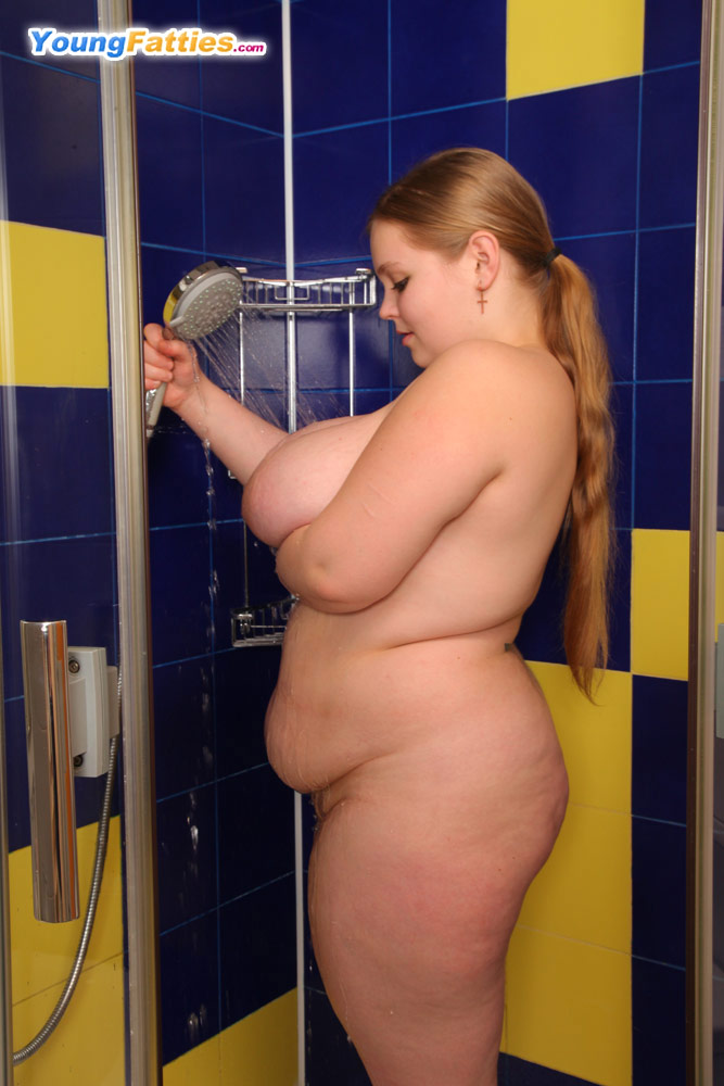 Busty redhead in the shower